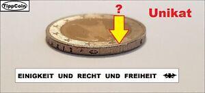 2 Euro Fehlprägung, die JESUS-Münze ist unter allen Münzen.