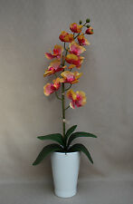 REAL TOUCH PINK / ORANGE ORCHID WITH LEAVES PLANTED IN WHITE CERAMIC PLANT POT