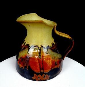 "STUDIO ART POTTERY SIGNED STONEWARE EARTHTONE DRIP GLAZE 7"" WIDE SPOUT PITCHER"