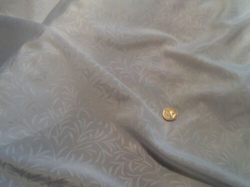"Fancy white self print polyester dress lining fabric  £2.65//m 1.12m//44/"" wide"