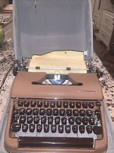 Vintage Olympia DeLuxe Portable Brown Typewriter SM3 with CASE