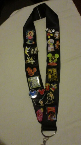 DISNEY LANYARD  BLUE IN COLOR 2 INCHES WIDE  39 INCHES LONG WITH METAL CLASP