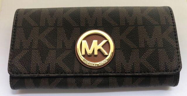 b2e74ef796b0 Buy Michael Kors Women's Logo Charm Leather Wallet Baguette online ...