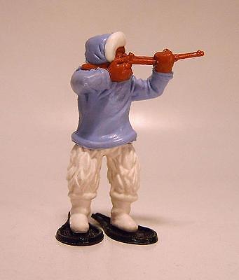Timpo Toys Eskimo mit Gewehr schiessend gelb
