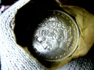 1884-o Blast White Unc Morgan Silver Dollar from a fresh Roll Will Grade Out