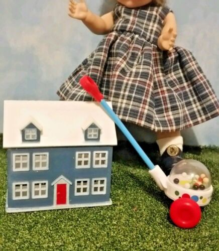 A doll house and FP popcorn popper toy for gifts Ginny/'s birthday party