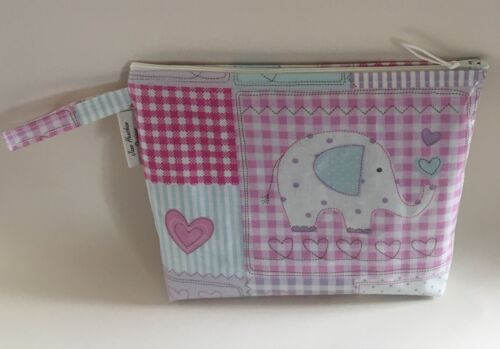 Nappy baby Wipes Holder clutch hand made in pink elephant oilcloth