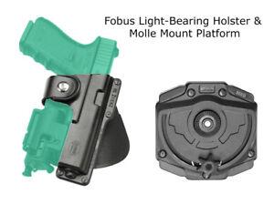 Details about Fobus Light Bearing Holster & Molle Platform G17,19, SIG  P226, Colt 1911, PX4