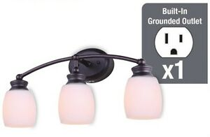 Oil rubbed bronze 3 light vanity light with built in - Bathroom lighting with built in outlet ...