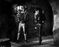 El Dorado Two Men Walking In Black Cowboy Outfit High Quality Photo