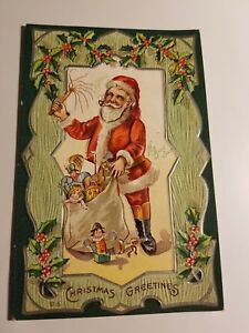 1910-A-JAEGER-CHRISTMAS-SERIES-18-HIS-BUSY-DAY-SANTA-WITH-BAG-OF-TOYS-UNPOSTED