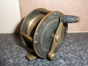 """VINTAGE BRASS 2 1/2"""" FISHING REEL ON OFF/RATCHET GOOD CONDITION FOR AGE"""