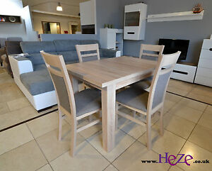 set of extending dining table and 4 solid wood chairs small great