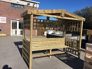 Wooden-arbour-pergola-with-seating-Pressure-treated-enclosed-garden-bench-summer