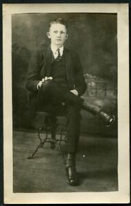 RPPC-HANDSOME-YOUNG-MAN-on-METAL-CHAIR-ANTIQUE-REAL-PHOTO-POSTCARD-c-1925