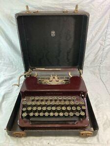 Vintage Smith Corona burgundy typewriter with case