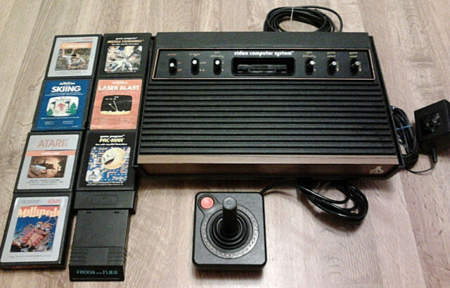 Atari 2600 Woodgrain  Six Switch  Console (NTSC)  Eight Games and Accessories