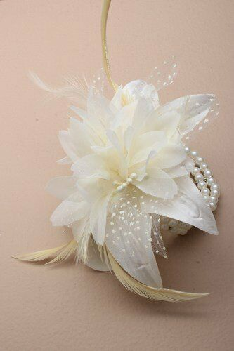 Wrist corsage in white with feather and flowers