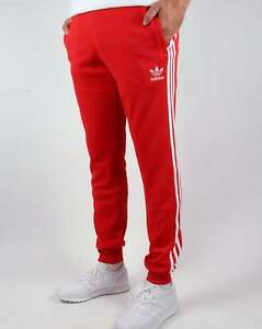 adidas superstar cuffed track pants red