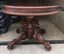 WALNUT AND BURL CARVED GRIFFIN TABLE