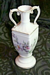 "8.5"" White porcelain Urn style floral Vase with gold accents from L & M Co."