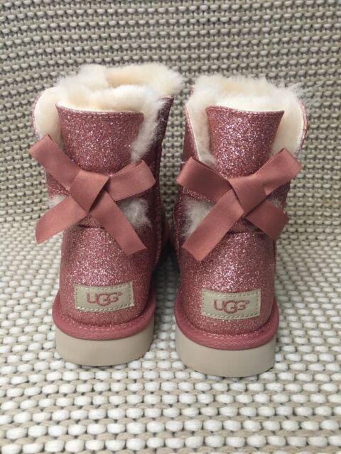 711bc99b063 UGG Women's Mini Bailey Bow Sparkle Sheepskin Boots Pink Size 7