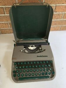 Vintage Smith-Corona Skyriter Typewriter with metal…lock on cover
