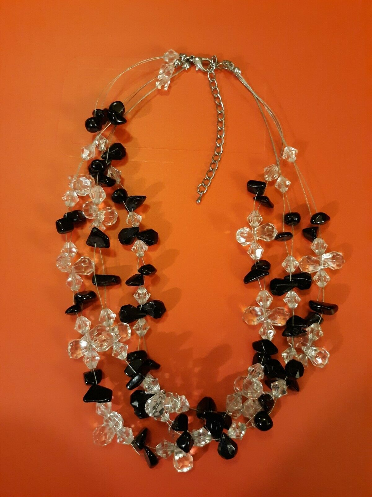 Black And Clear Plastic Beads Triple Strand Necklace