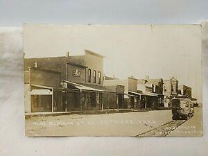 1913-Jetmore-Kansas-Main-Street-RPPC-C-C-Slack-Fantasy-Street-Car-Scene