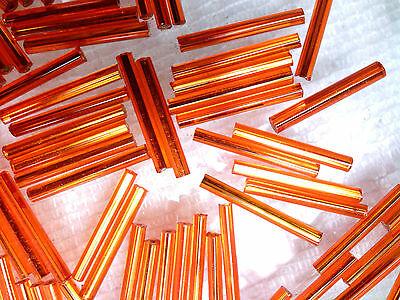 Vtg 100 ORANGE 19 mm GLASS BUGLES #072711x