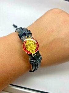 St Benedict leather adjustable bracelet. Red and gold medal. Black cord. Unisex