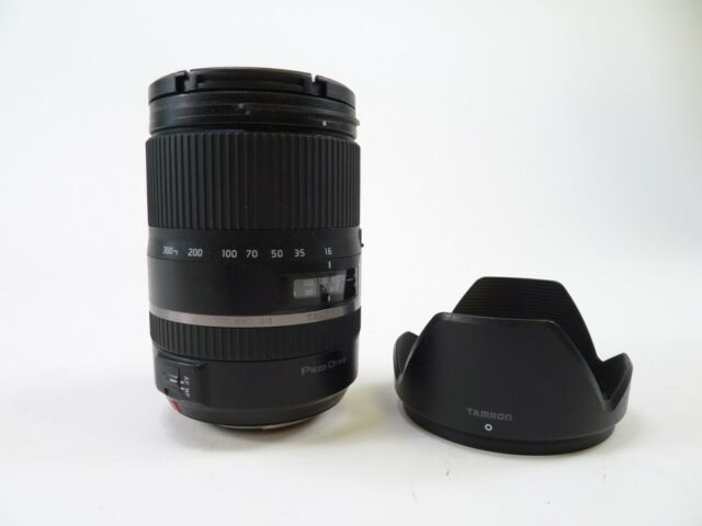 Tamron 16-300mm F/3.5-5.6 lens for A Mount with caps and hood. In EC.