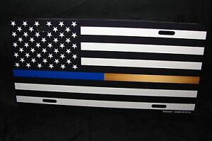 THIN GOLD AND THIN BLUE LINE METAL LICENSE PLATE BLACK AND WHITE AMERICAN FLAG