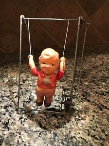 Antique Japanese Vintage Celluloid Baby Trapeze Tin Toy Works!