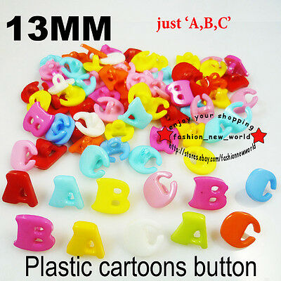 200PCS alphabet mixed PLASTIC cartoons color sewing clothing button CHARMS P-033