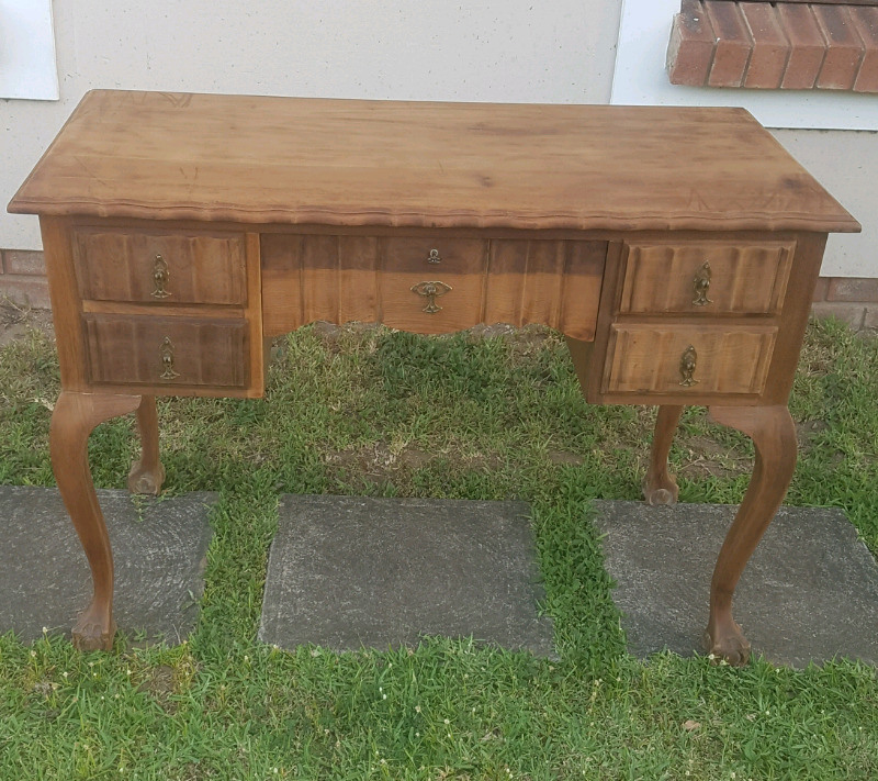 Ball and claw desk