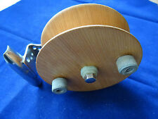 "AN UNUSUAL 4 1/2"" WOODEN CENTREPIN REEL"