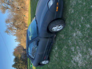 For Sale or Trade.      1997 Sunfire Convertible.