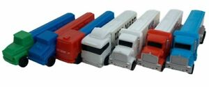 Lot Of 7 Assorted B, C, D, And E Series Collectible Pez Dispenser Semi Trucks