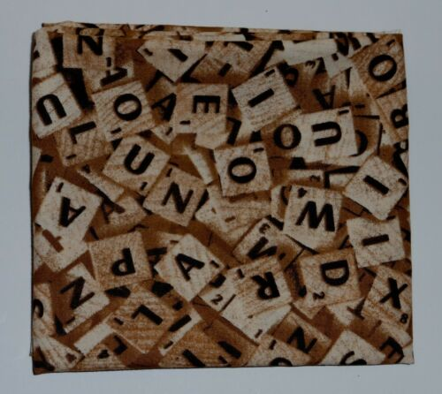 fat quarter of cotton poplin with scrabble tiles in brown