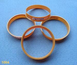 (1064) 4x  Zentrierringe  57,1 / 56,1 mm schwarz / orange / für Alufelgen