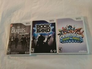 Lot of 3 Wii Games The Beatles Rockband , Rock Band , And Skylanders Swap Force