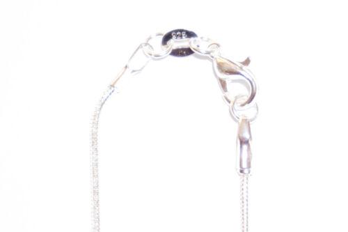 Cadena de plata con ovalem rhodonit-remolque