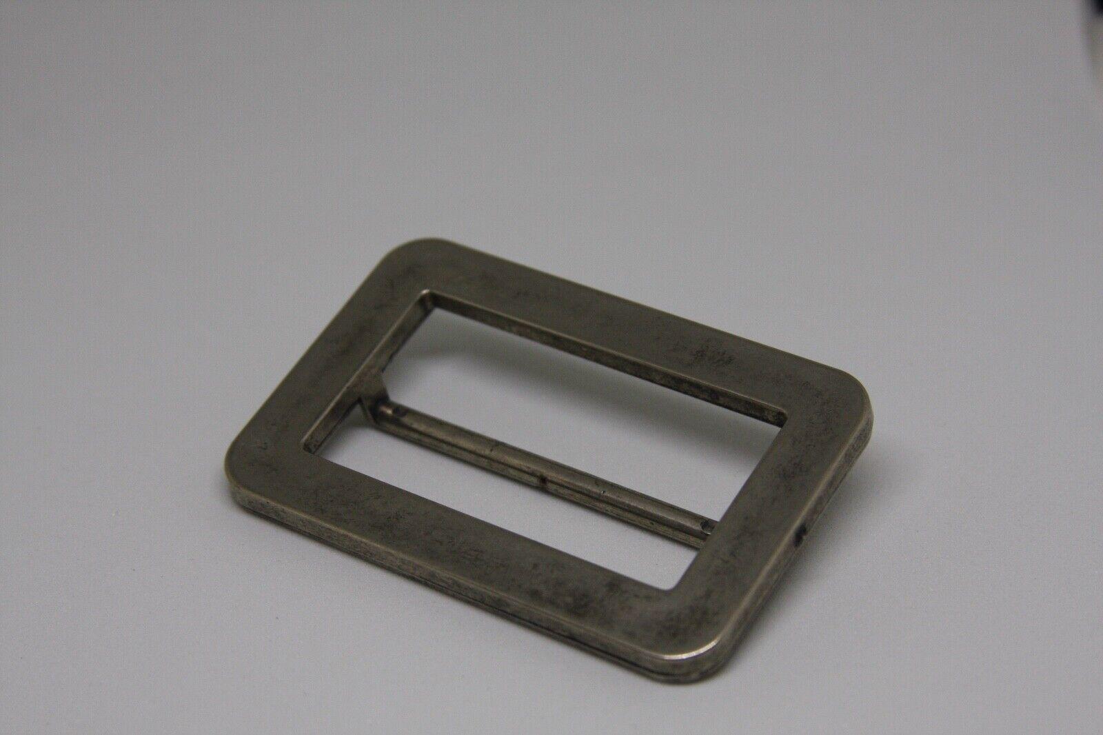 woman`s silver color, metal belt buckle