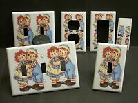 Raggedy Ann And Andy Hugs On White 2 Light Switch Or Outlet Cover