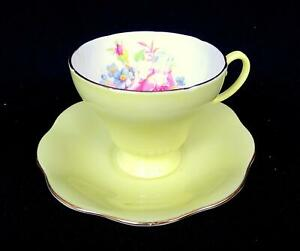 "EB FOLEY ENGLAND PINK & BLUE FLORAL ON YELLOW GOLD RIM 2 3/4"" CUP AND SAUCER"