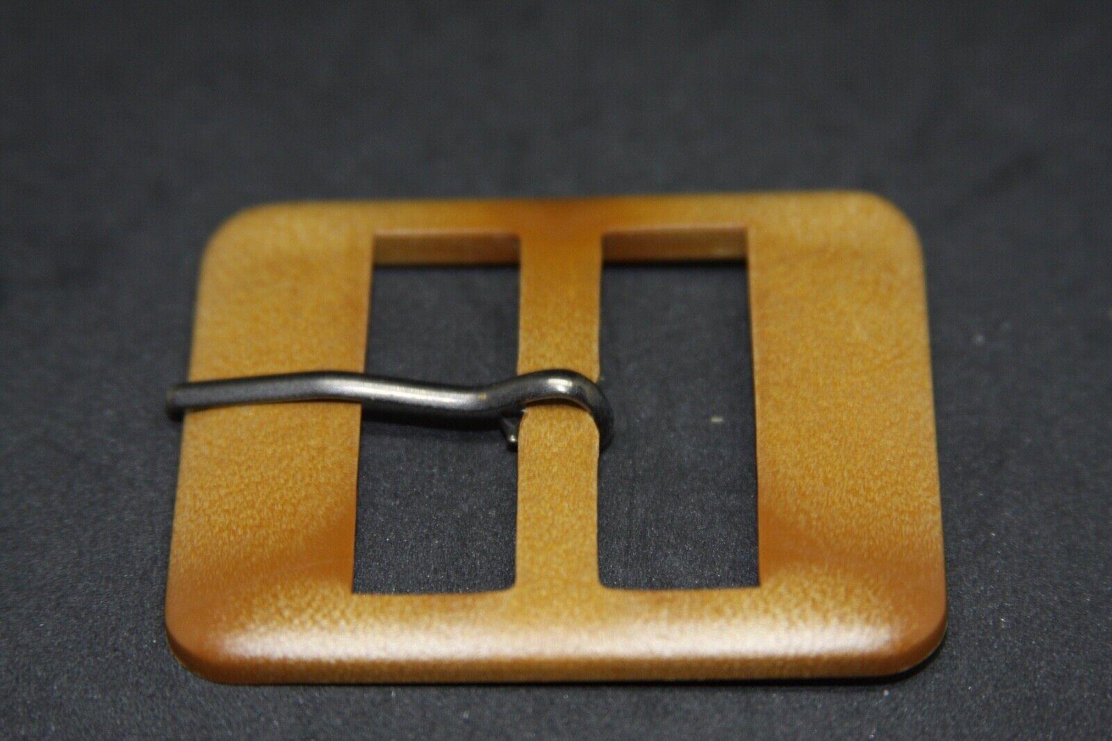 Woman`s Plastic, Italy, belt buckle