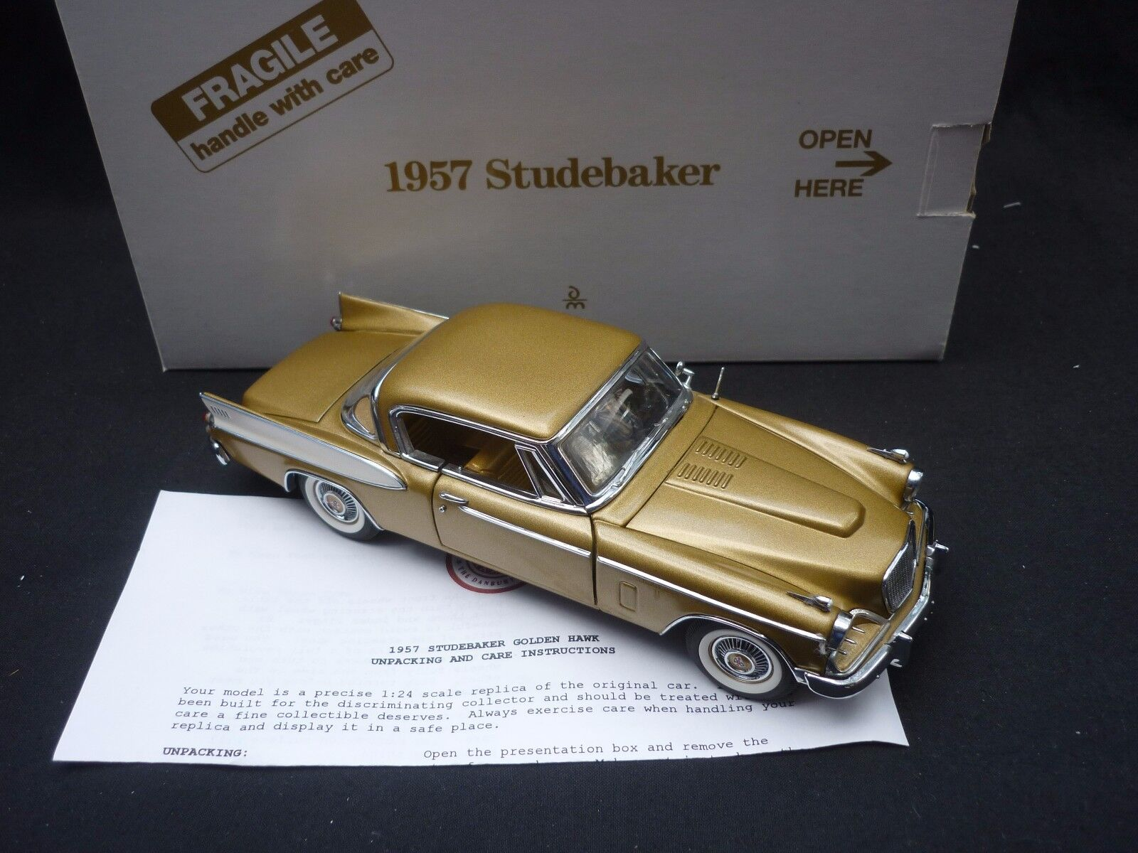 A Danbury mint  1957 Studebaker, boxed,  ( NM with leaflet.  )