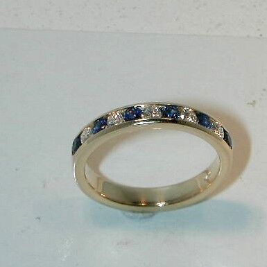 SAPPHIRE AND DIAMOND RING-CHANNEL SET IN 14KT Y.G.