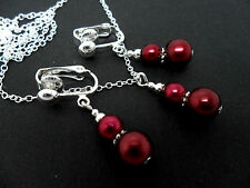 A DARK  RED PEARL  NECKLACE AND CLIP ON  EARRING SET. NEW.